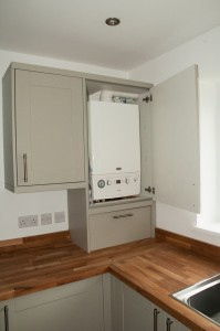 Cupboard concealing water heater
