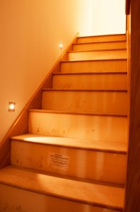 A stairway with recessed lights
